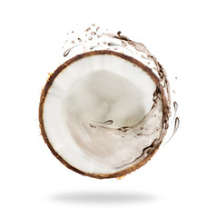 Piece of cut coconut with splashes of juice, isolated on white background