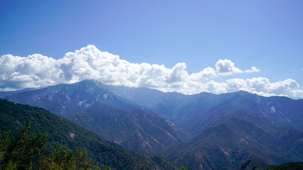 Mountain Top Vista with Blue Sky and Clouds