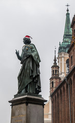 Copernicus sculpture in Thorn Poland in Santa Claus hat during Christmas winter