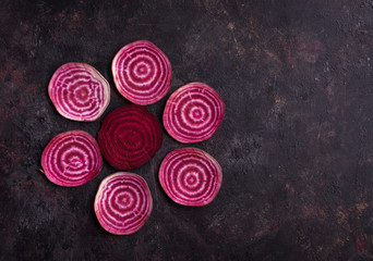 Pattern of sliced beetroot arranged on grunge  background. Top view with copy space