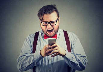 Man having annoying problems with smartphone