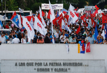 Supporters of the Chilean presidential candidate Alejandro Guillier hold flags during the closing campaign rally in Santiago.
