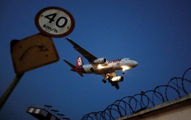 A LATAM Airlines plane with the old TAM logo livery prepares to land at Congonhas airport in Sao Paulo, Brazil