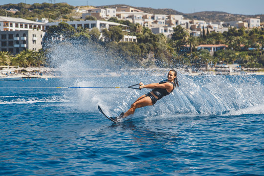 Water skis glides on the waves, female athlete on Aegean Sea,