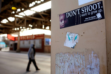 """A mural that reads """"Don't Shoot"""" is displayed on a pillar in Chicago"""