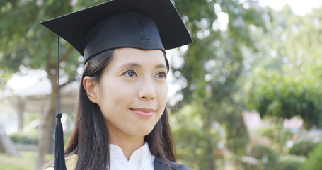 Woman wear graduation gown