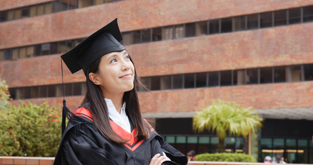 Graduation woman thinking of future