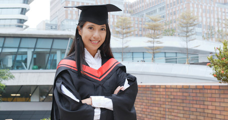 Confident woman get graduated in university