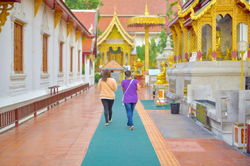 People walking in the temple