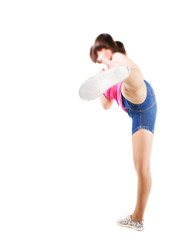 Young girl kicking with her leg in the camera, outsole close-up, isolated on white