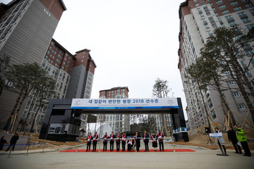 Participants take part in a completion ceremony of the Olympic Village in Pyeongchang