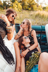 Girls lie in a gig and pose on camera