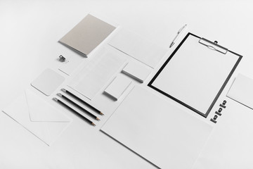 Photo of blank stationery set. Corporate identity template on white paper background. Mock up for placing your design. Responsive design mockup.