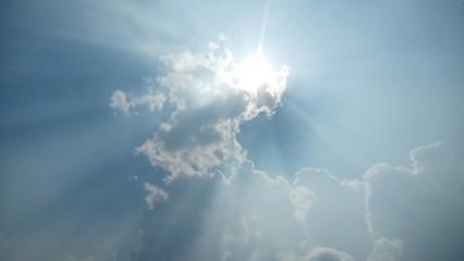 Sun on cloudy sky photo