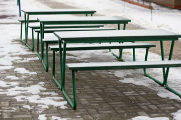 tables with snow on the street