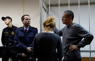 Russian former Economy Minister Alexei Ulyukayev, who was charged with accepting a bribe, waits for the start of a court hearing in Moscow