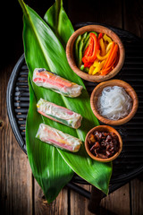 Closeup of delicious and fresh spring rolls on green leaf