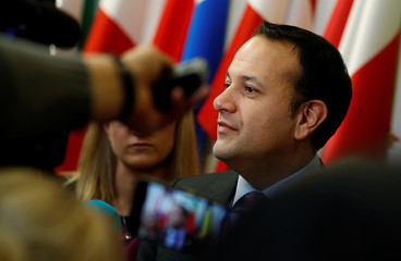 Ireland's Taoiseach Leo Varadkar talks to reporters as he arrives for the second day of the European Union leaders summit in Brussels, Belgium