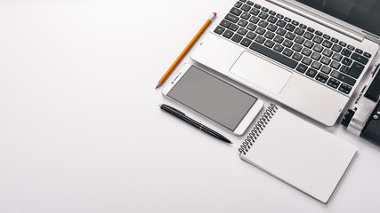 Graphic designer. Laptop, notebook, pencil. Top view. On a white background. Free space for text.