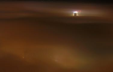 General view shows evening fog covering Skopje