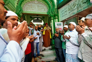 Muslims pray on the steps of a mosque during a demonstration against the U.S. decision to recognize Jerusalem as the capital of Israel, in Mumbai