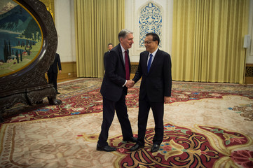 China's Premier Li Keqian meets Britain's Chancellor of the Exchequer Philip Hammonds at the Great Hall of the People in Beijing