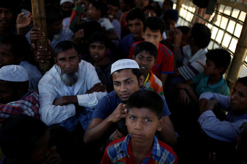 Rohingya refugees wait for food distribution at the Balukhali refugee camp near Cox's Bazar