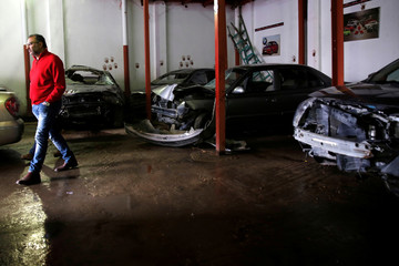 A customer is seen at the workshop of El Fauquier (The Poor), a crash-damaged vehicles and second-hand car shop, in Cairo