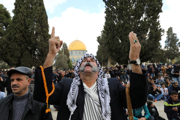 """Worshippers pray during Friday prayers on the compound known to Muslims as Noble Sanctuary and to Jews as Temple Mount in Jerusalem's Old City, as Palestinians call for a """"Day of Rage\"""