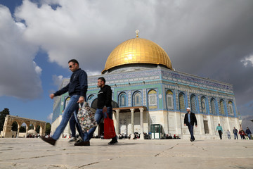 """Worshippers walk around before Friday prayers on the compound known to Muslims as Noble Sanctuary and to Jews as Temple Mount in Jerusalem's Old City, as Palestinians call for a """"Day of Rage\"""