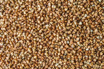 Textures from raw buckwheat grains. Healthy food. Top view.