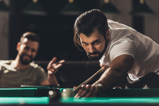 handsome caucasian man playing in snooker