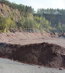 active quarry mine of porphyry rocks. digging.