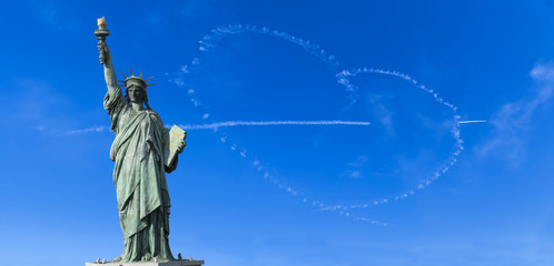 Statue of Liberty with heart airplane cloud background