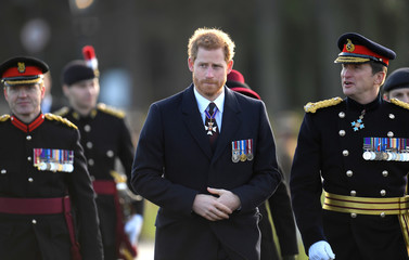 Britain's Prince Harry inspects the Officer Cadets who are passing out at the Sovereign's Parade at Sandhurst Military Academy, Sandhurst