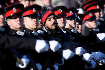 Officer Cadets who are passing out at the Sovereign's Parade, march past Britain's Prince Harry, Sandhurst Military Academy, Sandhurst