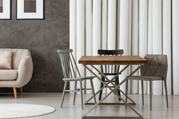 Grey chairs at designer table