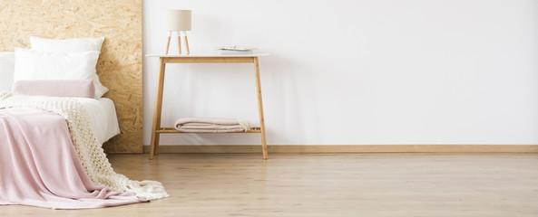 Wooden table in warm bedroom