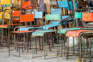 Rusted colorful old iron chairs