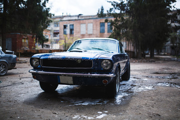 Old blue car washing on open air