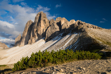 Last sun rays illuminating Tre Cime di Lavarado in Dolomite mountains, Italy, Europe