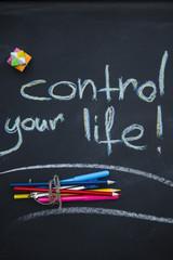 Control your life inscription on a blackboard