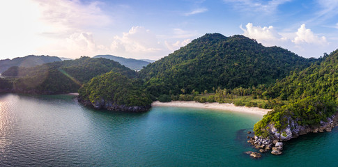 Aerial top view of scenic tropical beach with beautiful sunlight