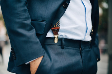 Midsection of businessman standing with hand in pocket