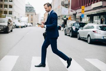 Businessman crossing street
