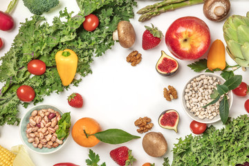 Vibrant fresh vegetables, fruits, cereals, and mushrooms on white background with copyspace