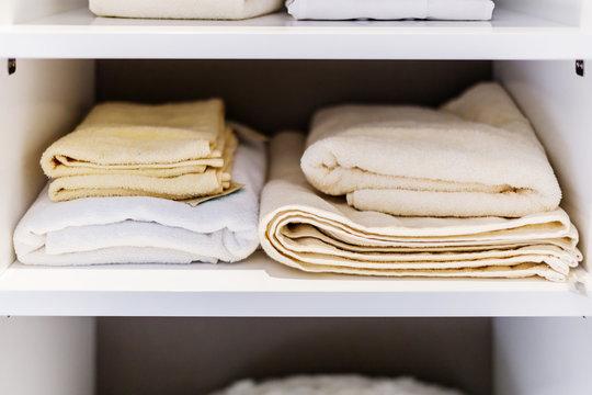 TOWEL CLOTH FOLD IN STACK IN WARDROBE SHELF INTERIOR CONCEPT