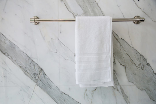 towel napkin on stainless stell rack in restroom