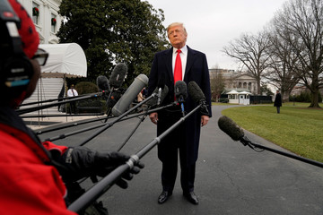 U.S. President Donald Trump listens to question from the media on South Lawn of the White House in Washington