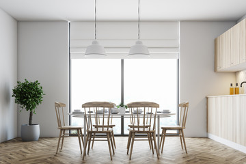 White dining room, wooden chairs